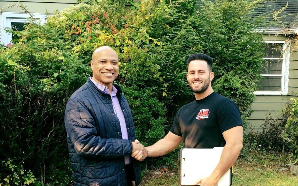 Anthony Zappia - All County Inspections shaking hands with client
