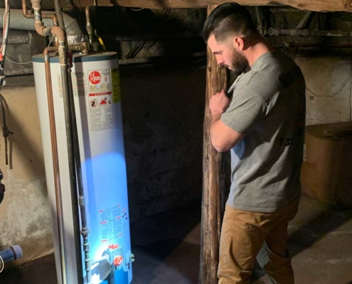 Matthew Zappia - All County Inspections inspecting a water heater