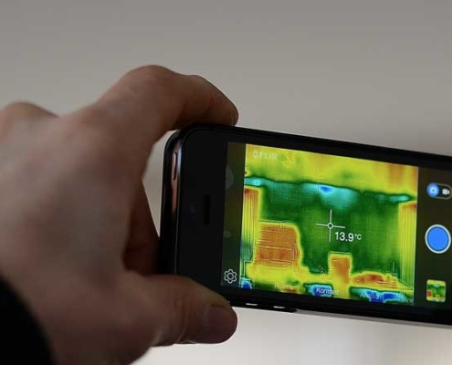 holding thermal imaging camera