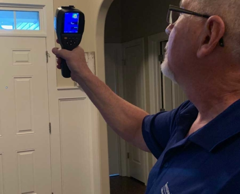 Bob, Owner and Inspector checking door using infrared imaging device